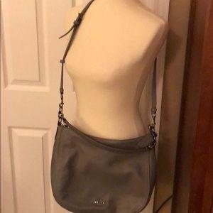 Gray leather Coach crossbody bag.